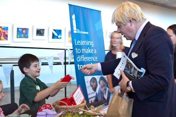 The Mayor of London Boris Johnson buys produce from Trafalgar Infant School students at the Schools Marketplace at City Hall. Photo: Jane Baker/Garden Organic.